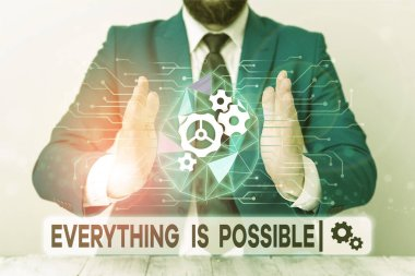 Text sign showing Everything Is Possible. Conceptual photo Any outcome could occur Anything can happen Male human wear formal work suit presenting presentation using smart device.
