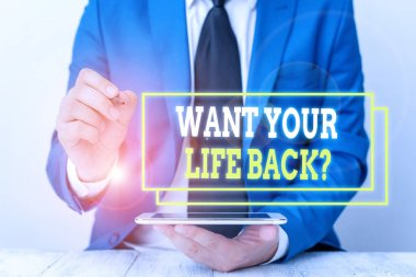 Conceptual hand writing showing Want Your Life Back Question. Business photo text Have again our Lives Take Control of our Being Businessman pointing with pen in empty copy space.