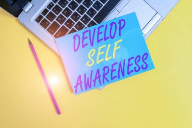 Conceptual hand writing showing Develop Self Awareness. Business photo showcasing increase conscious knowledge of own character Metallic laptop small paper sheet pencil colored background.