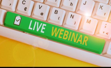 Handwriting text writing Live Webinar. Concept meaning Interactive seminar transmitted over the web Real Time White pc keyboard with empty note paper above white background key copy space.