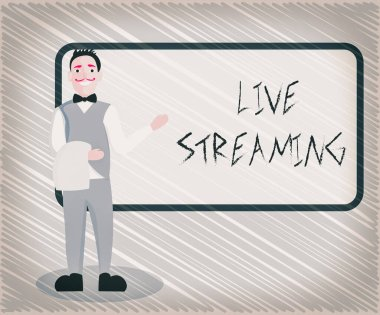 Text sign showing Live Streaming. Conceptual photo displaying audio or media content through digital devices Male Waiter Smiling Standing in Uniform Hand Presenting Blank Menu Board.