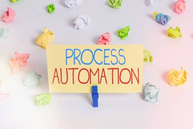 Conceptual hand writing showing Process Automation. Business photo showcasing the use of technology to automate business actions Colored crumpled paper empty reminder white floor clothespin.