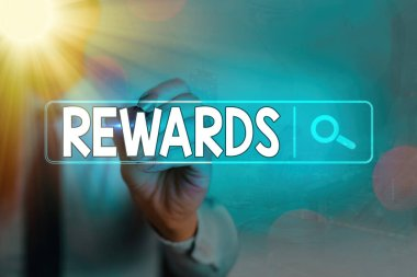 Writing note showing Rewards. Business photo showcasing certain number or percentage you earn for every dollar you charge.