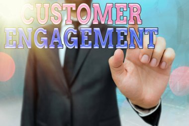 Writing note showing Customer Engagement. Business photo showcasing communication connection between a consumer and a brand Touch screen digital marking important details in business.