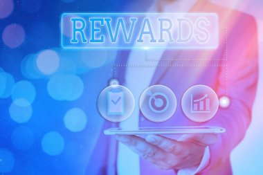 Handwriting text Rewards. Concept meaning certain number or percentage you earn for every dollar you charge.
