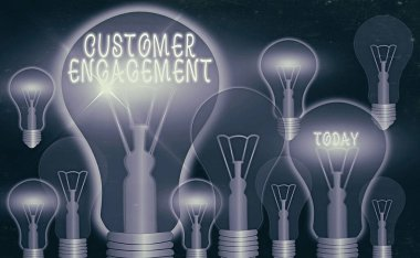 Writing note showing Customer Engagement. Business photo showcasing communication connection between a consumer and a brand Realistic colored vintage light bulbs, idea sign solution.