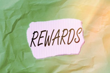 Writing note showing Rewards. Business photo showcasing certain number or percentage you earn for every dollar you charge Green crumpled colored paper sheet torn colorful background.