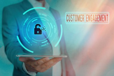 Handwriting text Customer Engagement. Concept meaning communication connection between a consumer and a brand Graphics padlock for web data information security application system.