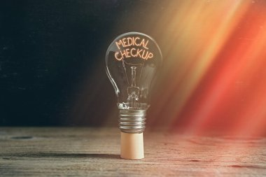 Handwriting text writing Medical Checkup. Concept meaning the examination carried out to determine the physical fitness Realistic colored vintage light bulbs, idea sign solution thinking concept.