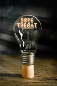 Word writing text Sore Throat. Business concept for Inflammation ot the pharynx and fauces resulted from an irritation Realistic colored vintage light bulbs, idea sign solution thinking concept.