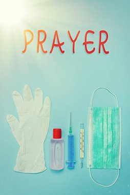 Writing note showing Prayer. Business photo showcasing solemn request for help or expression of thanks addressed to God Primary medical precautionary equipments for health care protection.