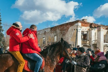 MOSCOW REGION, FRYAZINO, GREBNEVO ESTATE - MARCH 09 2019: Samy Naceri French star and actor of Taxi films and his brother Bibi Nacery mount a horse in front of big crowd visiting the Grebnevo