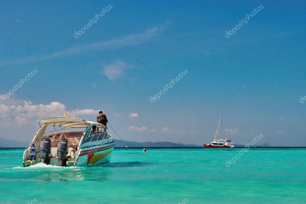 THAILAND, PHUKET, June 12, 2018-seascape with speed boat on the background of azure emerald water and blue clear sky.