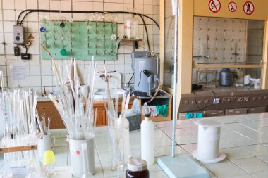 Laboratory equipment, flasks for research, preparation of solutions. Chemical medical supplies. Pipettes and peppers on the table. Scientific experiments