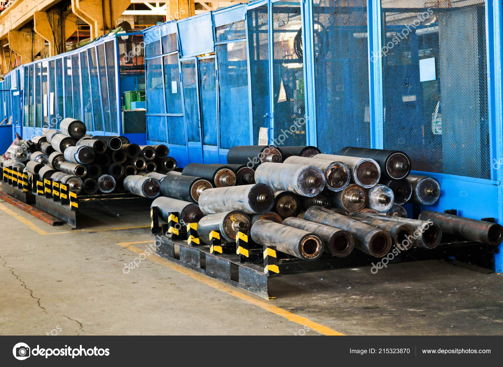 Warehouse, storage of iron rollers, pipes, spare parts at an