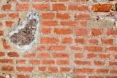 Textury staré starobylé středověké antické kámen tvrdé loupání popraskané zdi obdélníkové červené hliněné cihly a velké kameny, dlažební kostky. Na pozadí