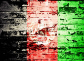 flag of Afghanistan painted on brick wall
