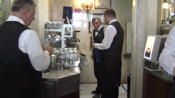 Naples, waiters serve coffee in the famous Gambrinus bar