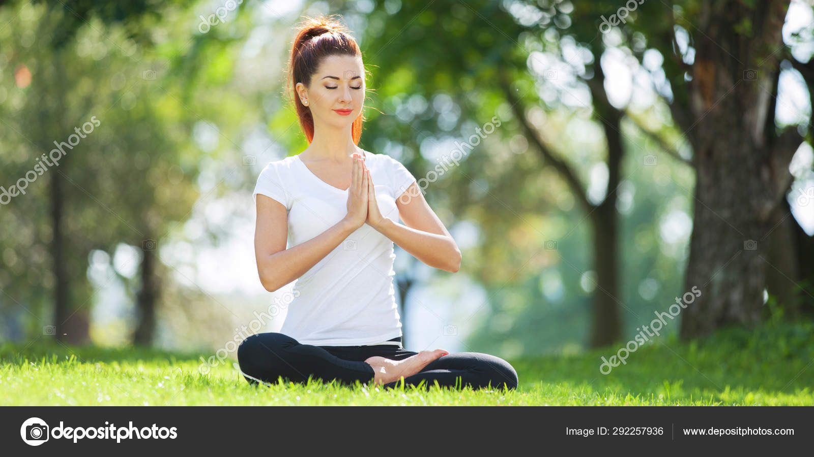Yoga Outdoor Happy Woman Doing Yoga Exercises Meditate In The Park Yoga Meditation In Nature Concept Of Healthy Lifestyle And Relaxation Pretty Woman Practicing Yoga On The Grass Stock Photo C
