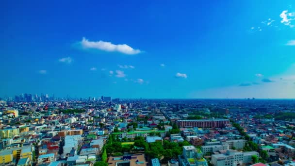 A timelapse of panoramic view at the urban city in Nerima Tokyo daytime wide shot