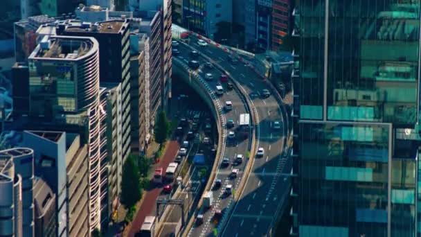 A timelapse of highway at the urban city in Tokyo long shot tilt