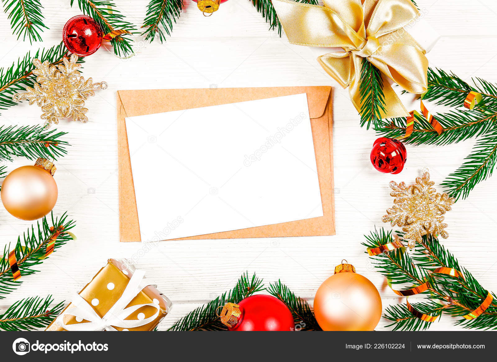 festive flat lay composition with blank invitation for new year celebration craft paper envelope christmas greeting card template concept
