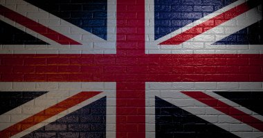 United Kingdom flag on the brick wall. 3d illustration of Union Jack. Great Britain flag painted on the brick wall. London