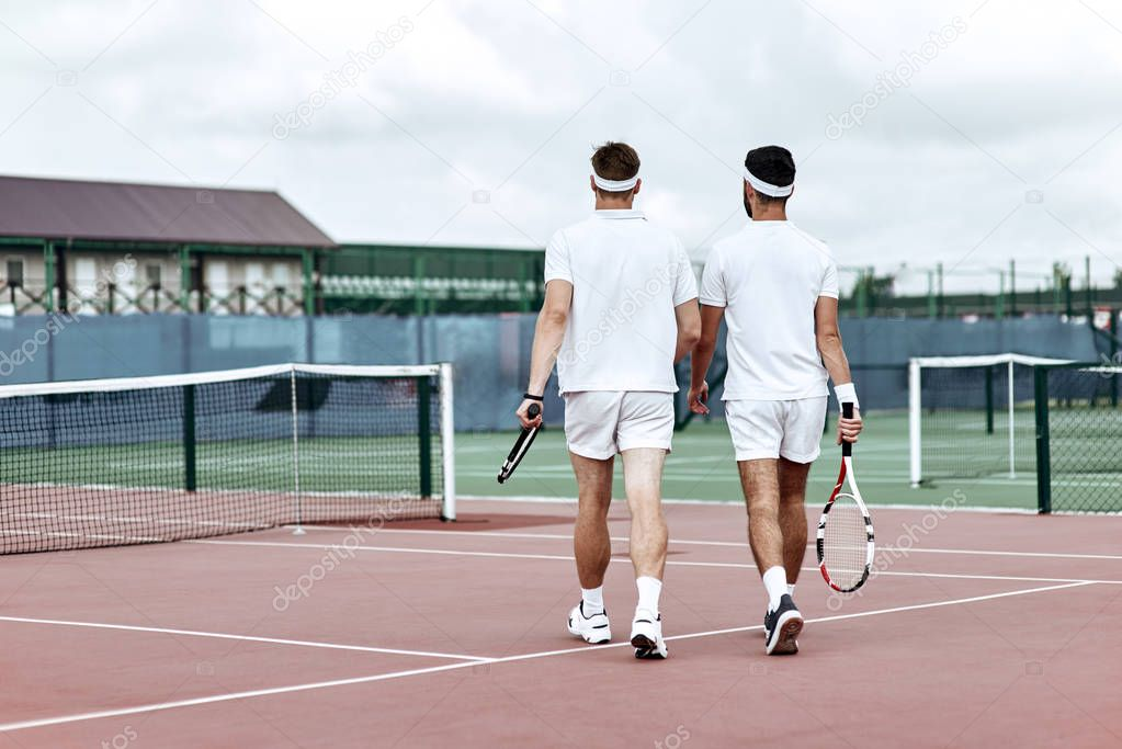 Never give up-Two tennis players leaving the tennis court