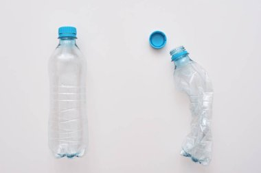 Dont scrum your world. Two plastic bottles, one is crumble