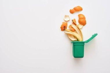 Organic garbage. Banana and orange peels, isolated