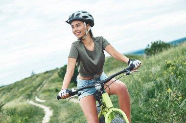 Mountain biking - woman with fatbike enjoys summer vacation