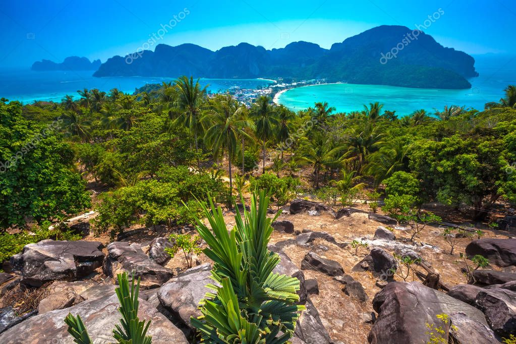 Beautiful panoramic view over Tonsai and Dalum Beach. Green jungles and hot stones on the bright sun of tropical island and the mountains in Andaman Sea. Phi Phi Viewpoint, Krabi, Thailand.