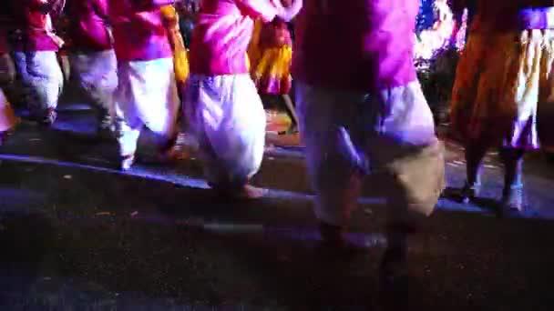 Focus leg of stick dancer at street during Thaipusam.