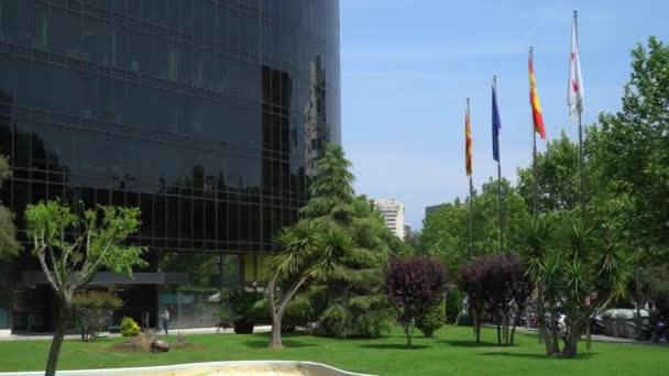 Barcelona, Spain - May 10, 2018: international flags near the office building
