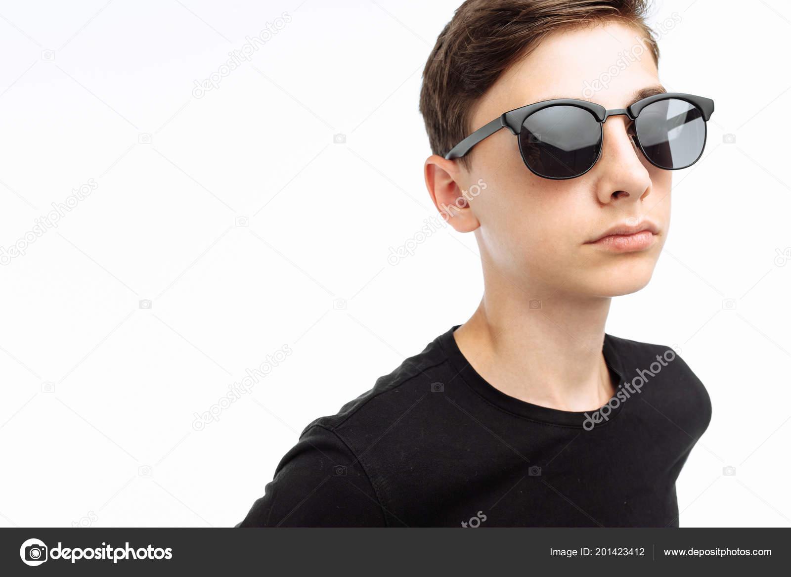 ef81305d390 Portrait Stylish Teenager Guy Glasses Black Shirt Posing Studio White —  Stock Photo