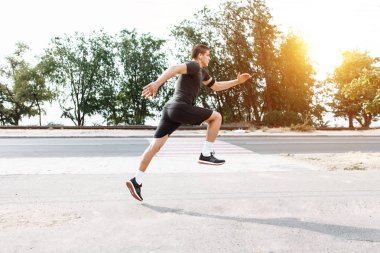 man makes a morning jog in the streets, sports training