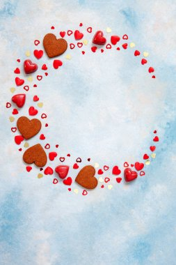 Wreath of sweets, cookies and heart figurines on  blue background. Concept for Valentine's Day, March 8th and other romantic holidays and events