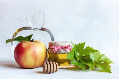 Apples and honey. Concept for Rosh Hashanah the Jewish New Year. Top view, close up on white background. stock vector
