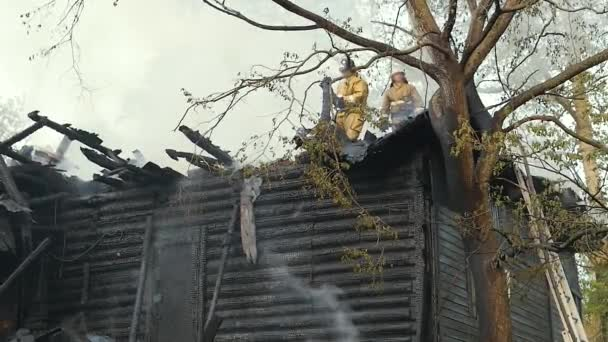 Firefighters extinguish the fire. Burning old abandoned house. Slow Motion Video