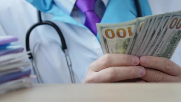 Corrupted medical doctor counting money. Doctor accepting bribe and counting dollar bills close-up. Concept of expensive medecine and healthcare