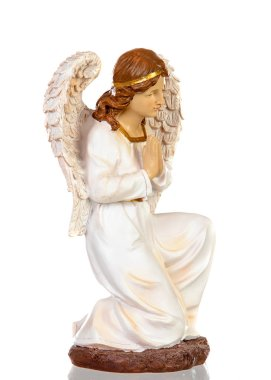 Ceramic figure of the angel of the nativity scene isolated on a white background