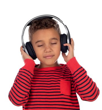 Latin child with headphones an red sweater isolated on a white background