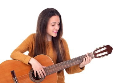Teenager girl playing a guitar isolated on a white background