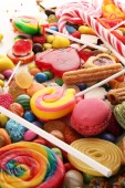 Photo candies with jelly and sugar. colorful array of different childs sweets and treats