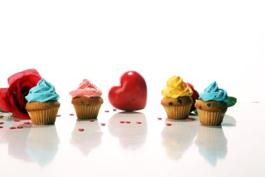 Delicious cupcake for Valentine Day with hearts. Traditional homemade with red roses