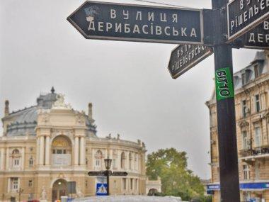 Odessa, Ukraine - January 7, 2014: famous deribasivska street sign in front of odessa opera theatre