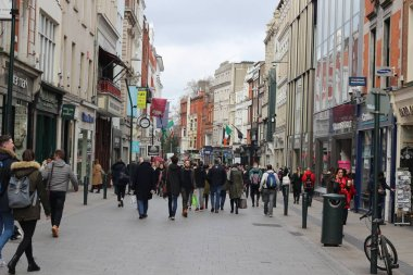 February 18 2018, Dublin Ireland: Editorial photograph of a large group of people walking down Dame St. Dame St is the tourist shopping district of Dublin.