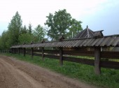 Fotografie View of the wooden fence in the village
