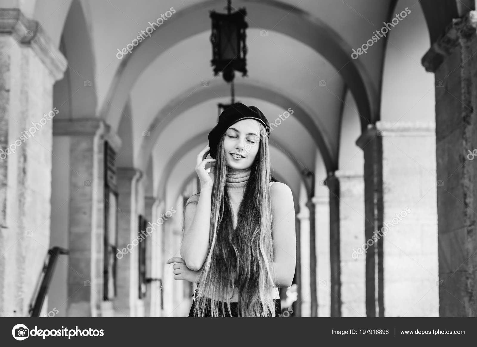 b11fe5ac4e64c Close-up of a girl with long hair and black beret which stands under the  arches with lanterns and closed her eyes on a black and white photo — Photo  by ...