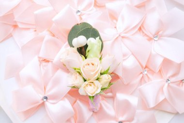 Beautiful boutonniere with roses against the background of small pink bows stock vector